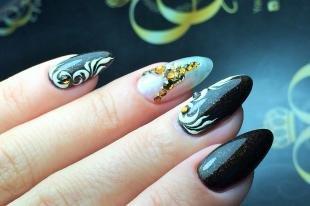 Рисунки на острых ногтях, роскошный черно-белый маникюр с камнями